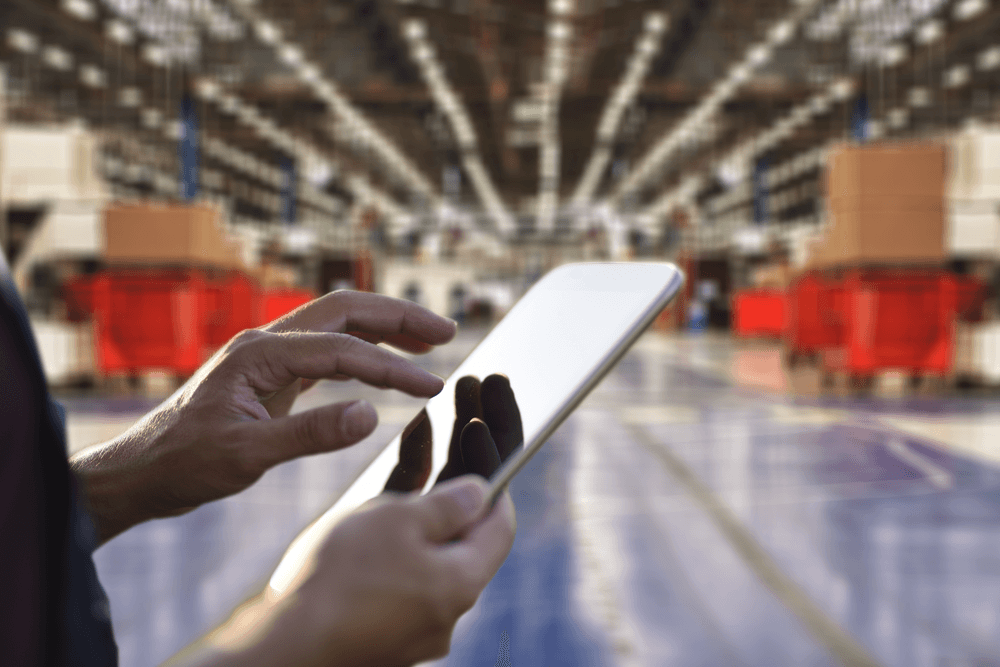 Man using tablet in warehouse